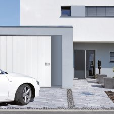 Portes de garage batiman experts en menuiseries et for Porte garage ouverture laterale