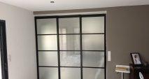 Séparation de pièces vitrée